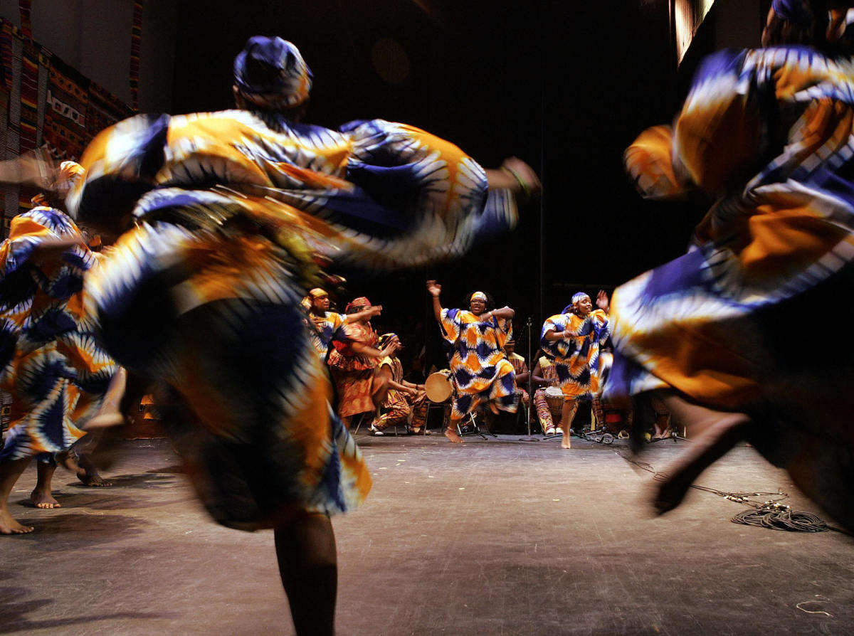African Heritage Dancers dance to the African Heritage Drummers during a Kwanzaa celebration at the Lincoln Theater in Washington, D.C. Kwanzaa is a pan-African holiday established in 1966 celebrating family, community, and culture through seven principles of unity, self-determination, collective work and responsibility, cooperative economics, purpose, creativity, and faith.