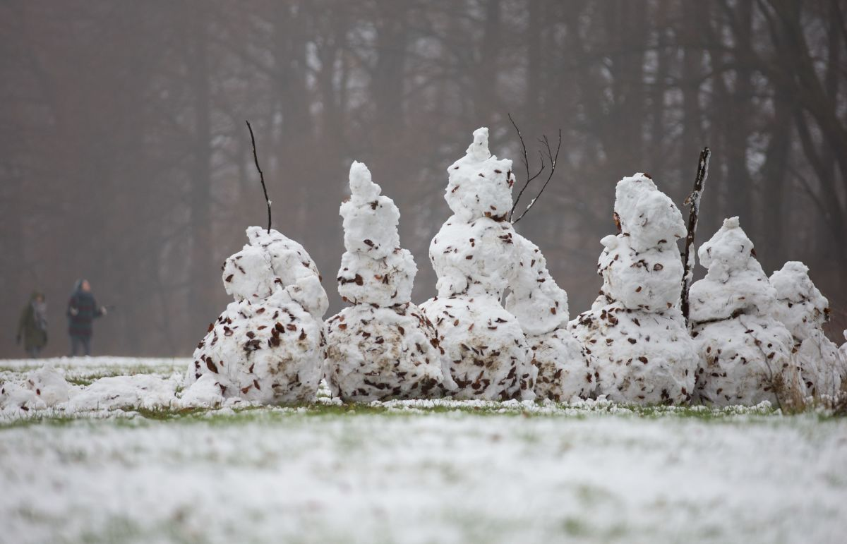 Snowmen stand on a field in Bielefeld, northwestern Germany.