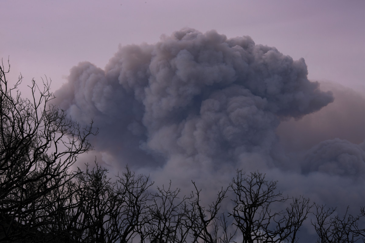 A plume of smoke is seen from Ojai, California, as the Thomas Fire grows and advances toward seaside communities on December 10th, 2017, near Carpinteria, California.