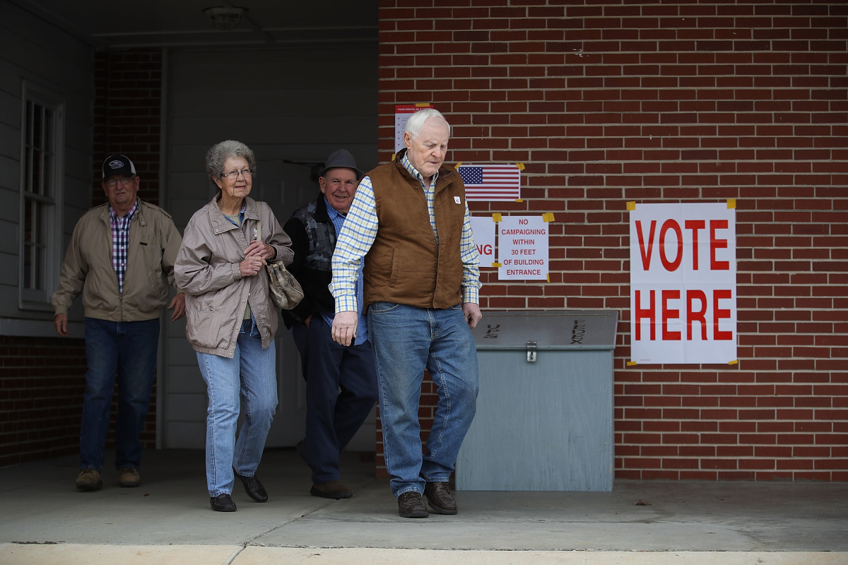 Voters exit after casting their ballots at a polling station setup in the Fire Department on December 11th, 2017, in Gallant, Alabama. Alabama voters are casting their ballot for either Republican Roy Moore or his Democratic challenger Doug Jones in a special election to decide who will replace Attorney General Jeff Sessions in the U.S. Senate.