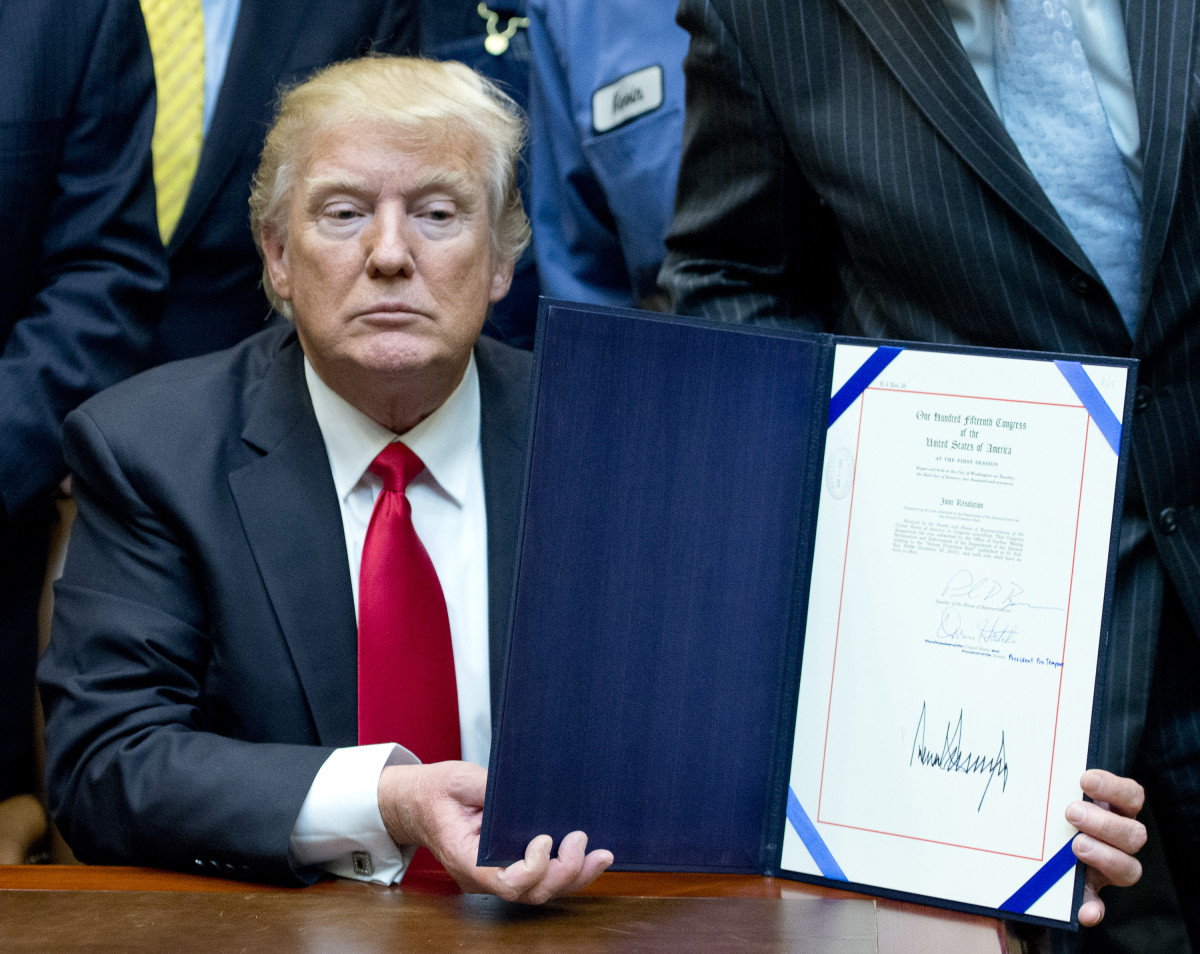 U.S. President Donald Trump signs H.J. Res. 38, disapproving the rule submitted by the U.S. Department of the Interior known as the Stream Protection Rule in the Roosevelt Room of the White House on February 16th, 2017, in Washington, DC.