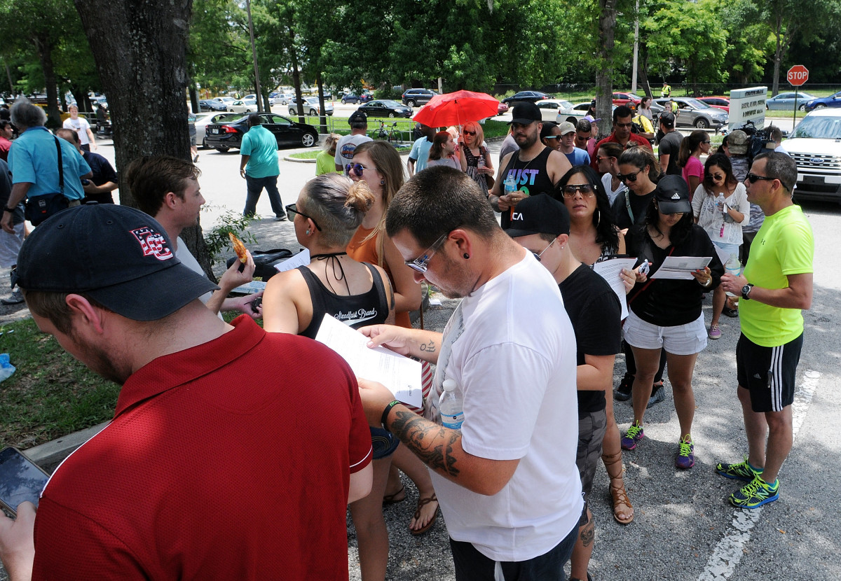 Long lines of people wait at the OneBlood Donation Center to donate blood for the injured victims of the Pulse nightclub shooting on June 12th, 2016, in Orlando, Florida.