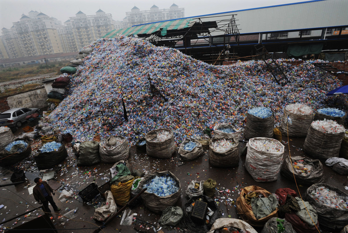 Used plastic bottles remain heaped up at a recycling mill in Wuhan of Hubei Province, China.
