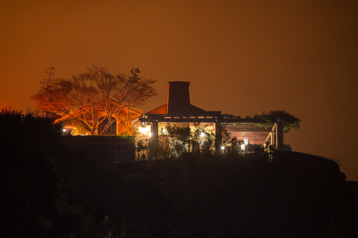 The Thomas Fire approaches a home on December 12th, 2017, in Montecito, California.