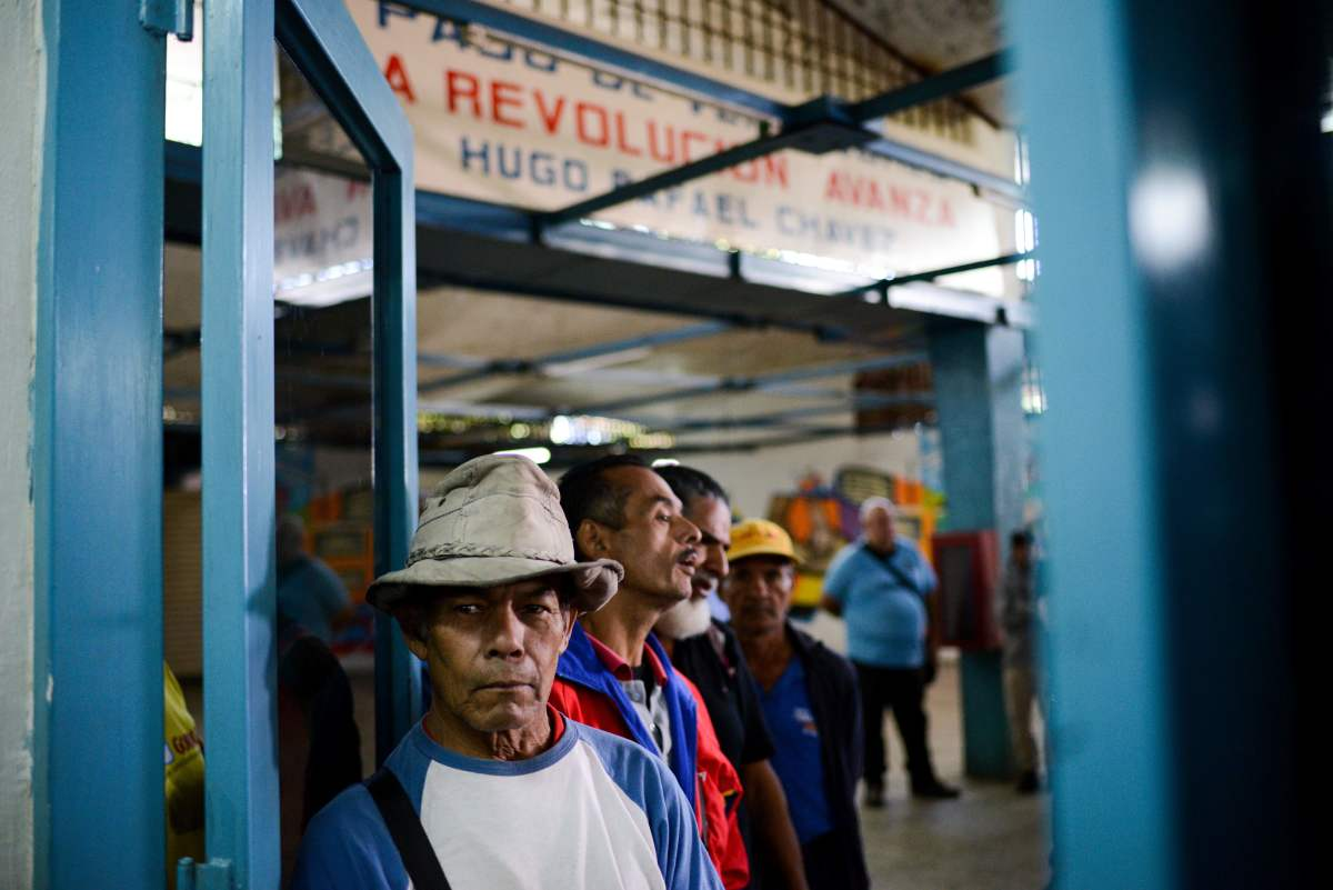 People line up outside the BanPanal communal bank to exchange bolivares for the new local community currency, the panal, launched in the 23 de Enero working-class neighborhood in Caracas, Venezuela, on December 15th, 2017.