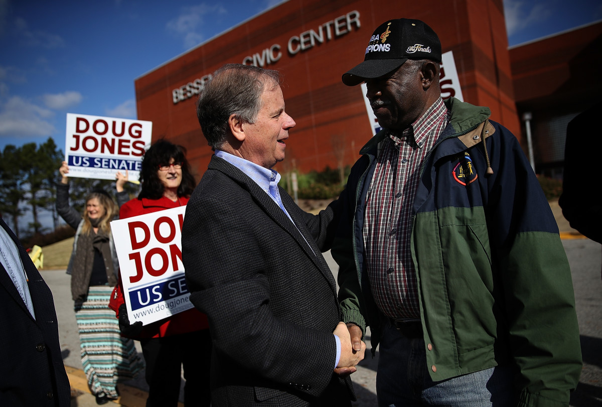 Democratic Senatorial candidate Doug Jones greets voters outside of a polling station at the Bessemer Civic Center on December 12th, 2017, in Bessemer, Alabama.
