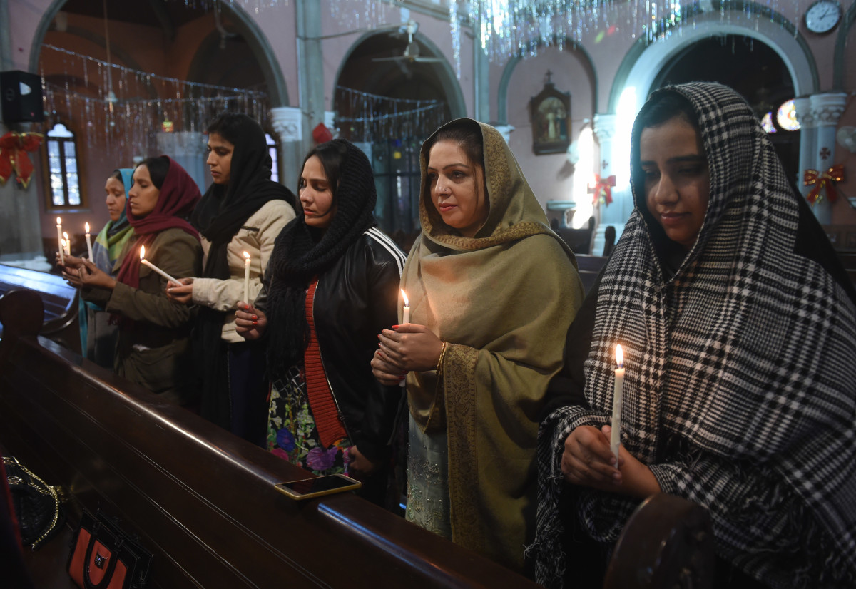 Pakistani Christians take part in a service on December 18th, 2017, for the victims of a suicide attack on a church at the Sacred Heart Cathedral in Lahore.