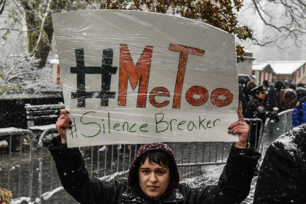 People carry signs at a #MeToo rally on December 9th, 2017, in New York City.