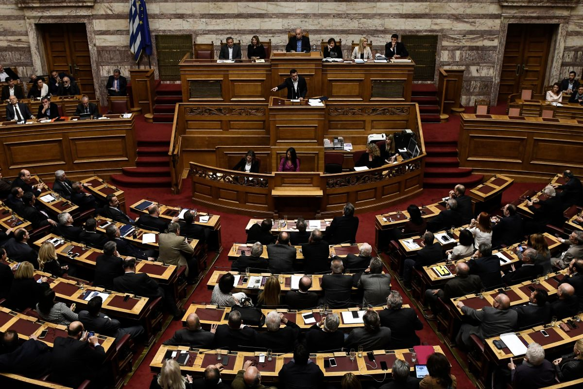 Greek Prime Minister Alexis Tsipras gestures as he delivers a speech during a parliamentary session in Athens on December 19th, 2017.