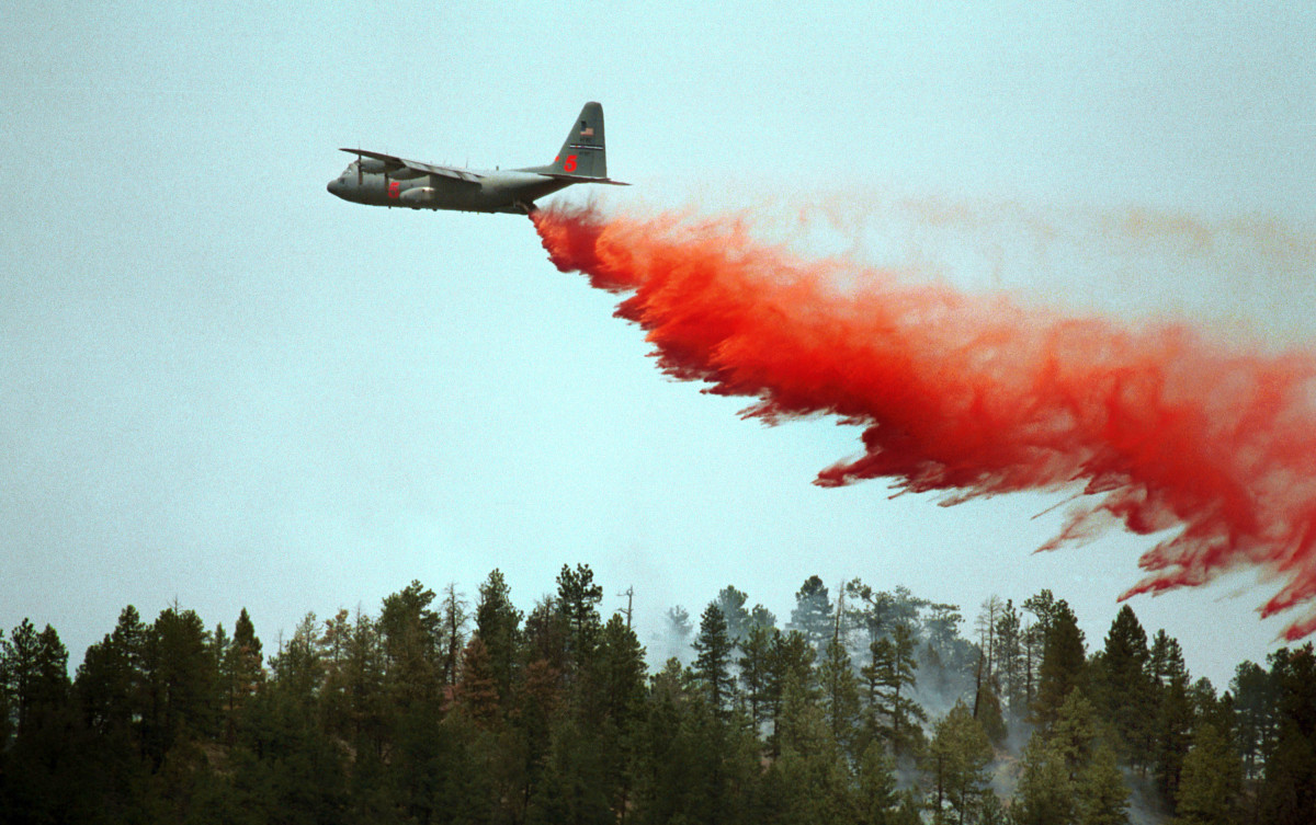 A slurry bomber drops its load on a ridge in an effort to stop the Hayman Fire on June 14th, 2002, in Deckers, Colorado.