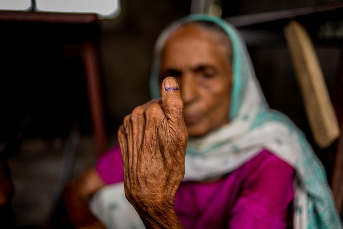 A Nepali woman shows her inked thumb after casting her ballot during the third phase of the Nepalese local elections at a polling station at Birgunj Parsa district, some 150 kilometers south of Kathmandu, on September 18th, 2017.