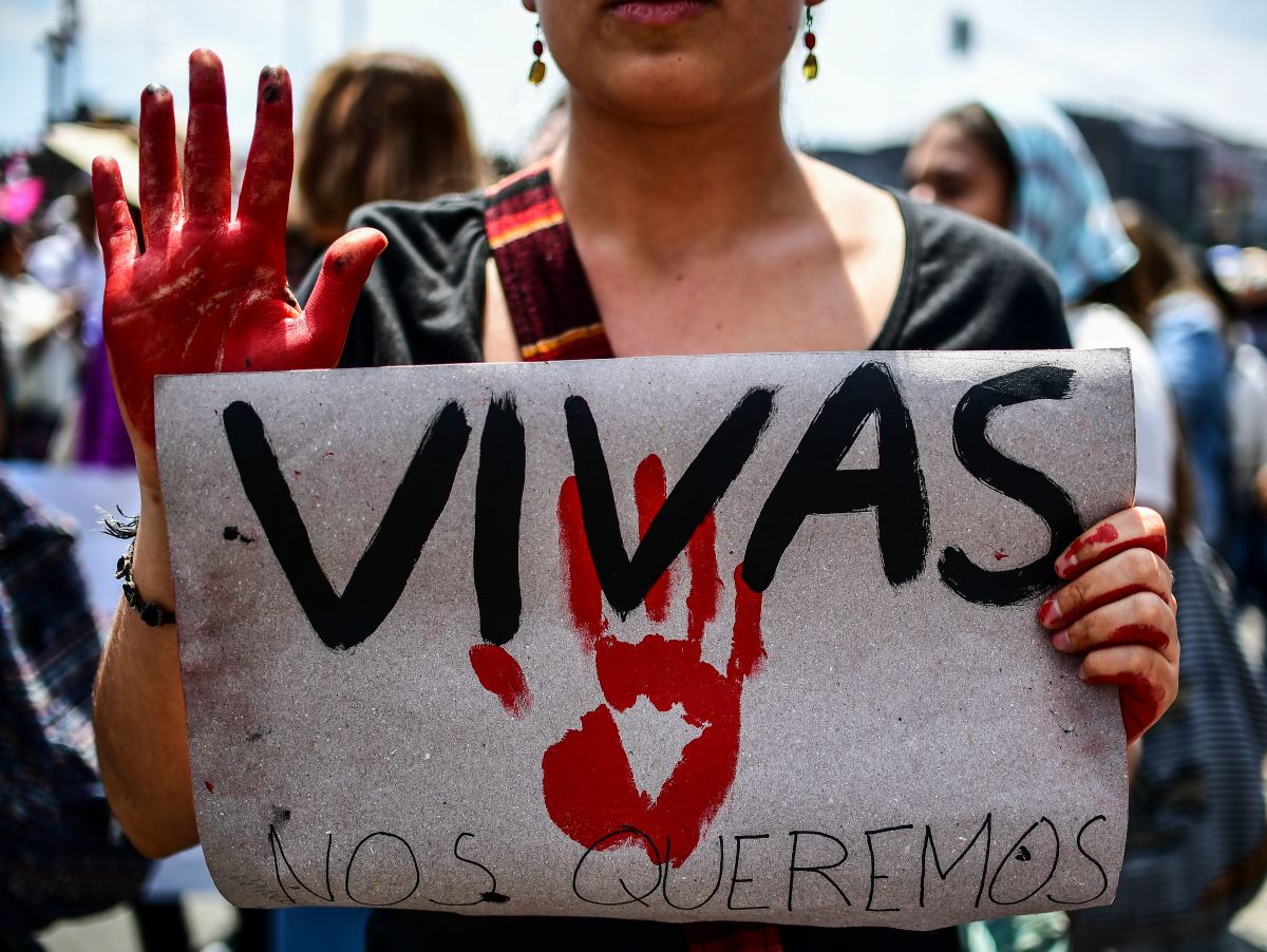 "A Mexican woman holding a sign reading ""We want us alive"" takes part in a protest against murders and other violence toward women in Mexico City on September 17th, 2017."