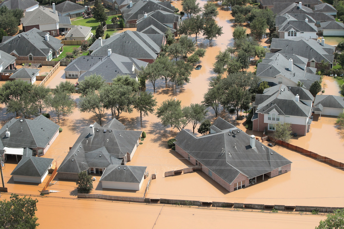 Homes are surrounded by floodwater after torrential rains pounded Southeast Texas.