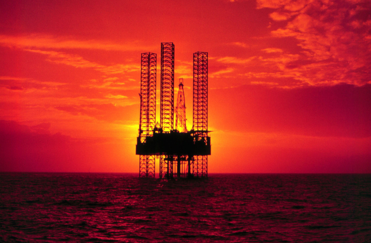 Pennzenergy Company Oil Exploration Drilling Rig in the Gulf of Mexico during sunset.