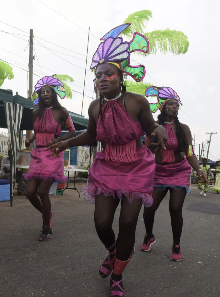 Performers dance during the Lagos Street Carnival on December 3rd, 2017, in Lagos. Commercial activities in the bustling Ikeja district of Lagos were grounded as people danced along the major roads to celebrate the second edition of the Lagos street carnival, heralding the Christmas and New Year's period.
