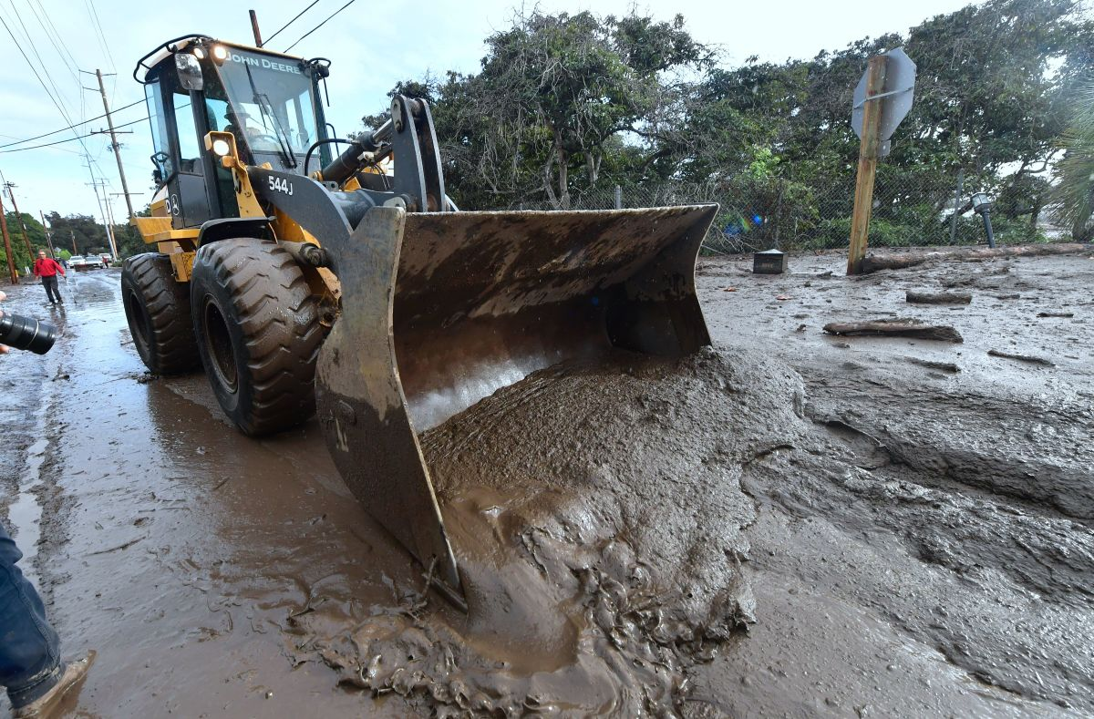 A bulldozer clears mud off the road near a flooded section of the 101 Freeway in Montecito, California, on January 9th, 2018.