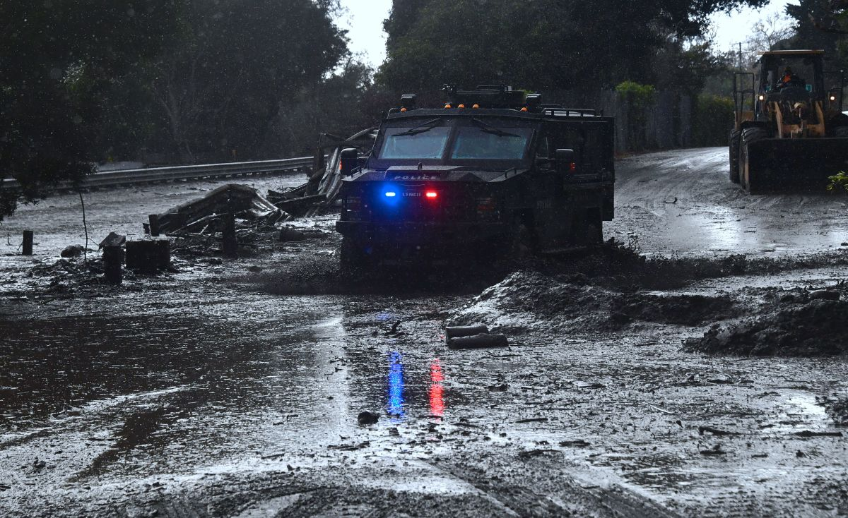 A police vehicle drives across a flooded side road off the 101 Freeway in Montecito, California, on January 9th, 2018.