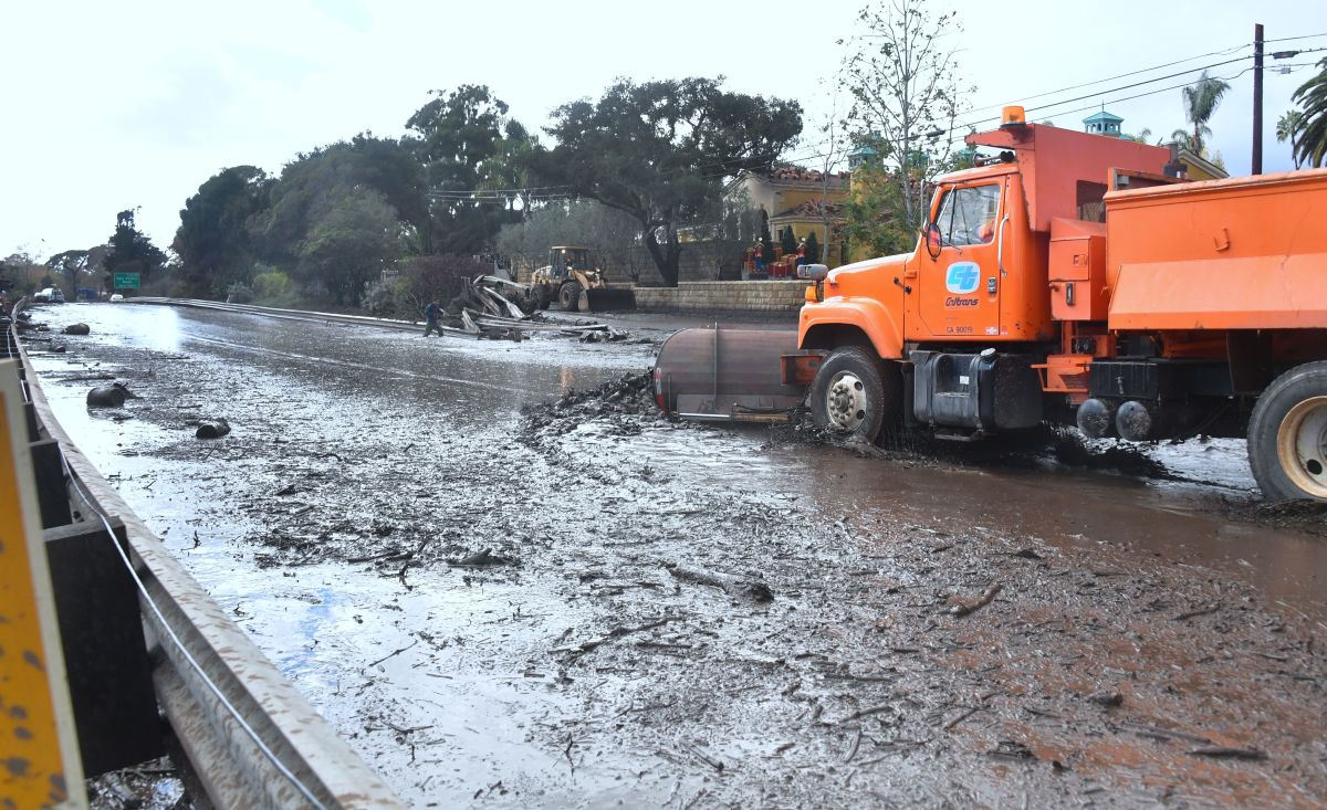 Mud and debris is cleared off a closed-off section of the 101 Freeway in Montecito, California, on January 9th, 2018.