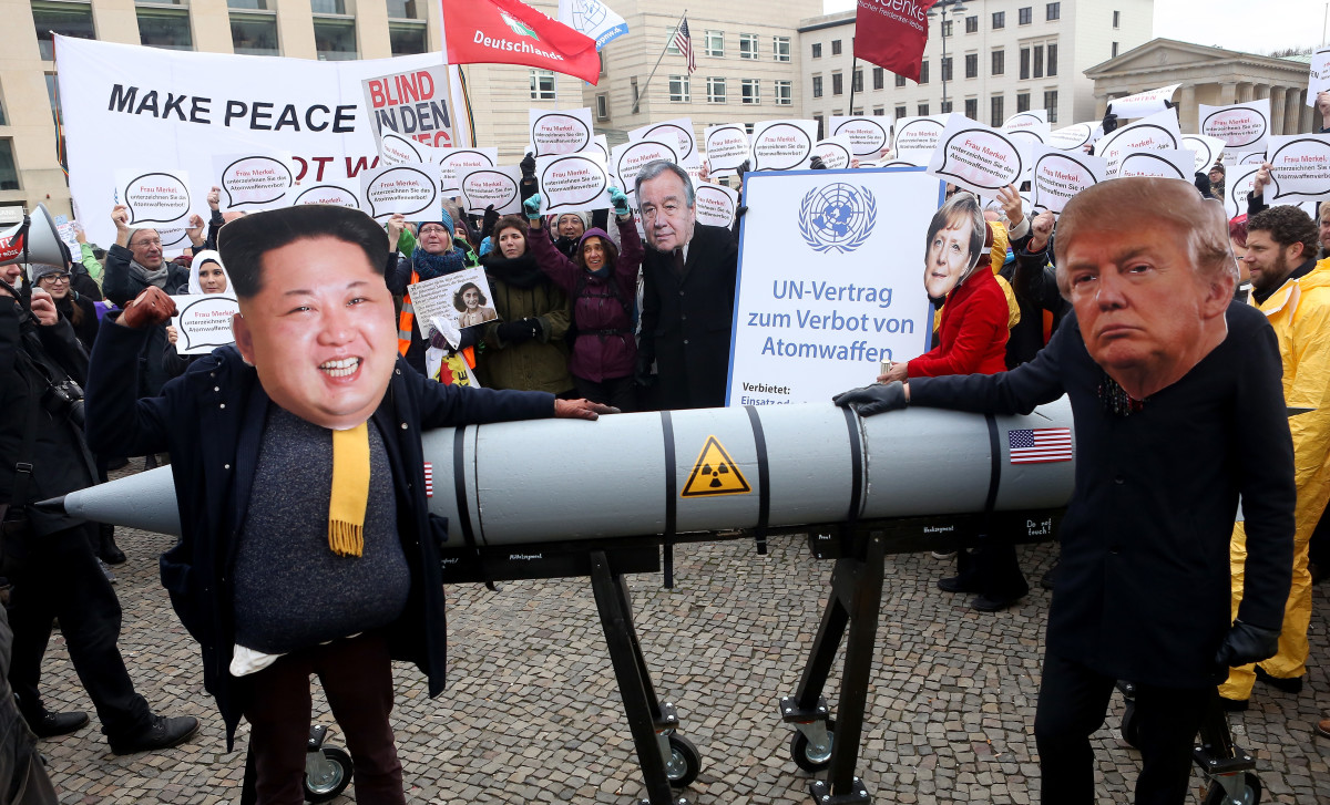 Activists dressed as North Korean leader Kim Jong-un and U.S. President Donald Trump march with a model of a nuclear rocket during a demonstration against nuclear weapons in Berlin on November 18th, 2017.