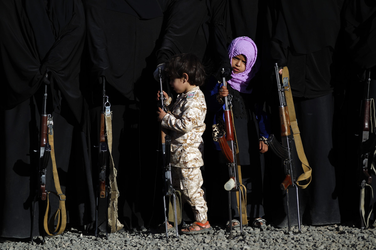 A Yemeni girl holds a rifle as she attends a gathering in Sanaa on January 14th, 2018, in support of the Houthi movement.