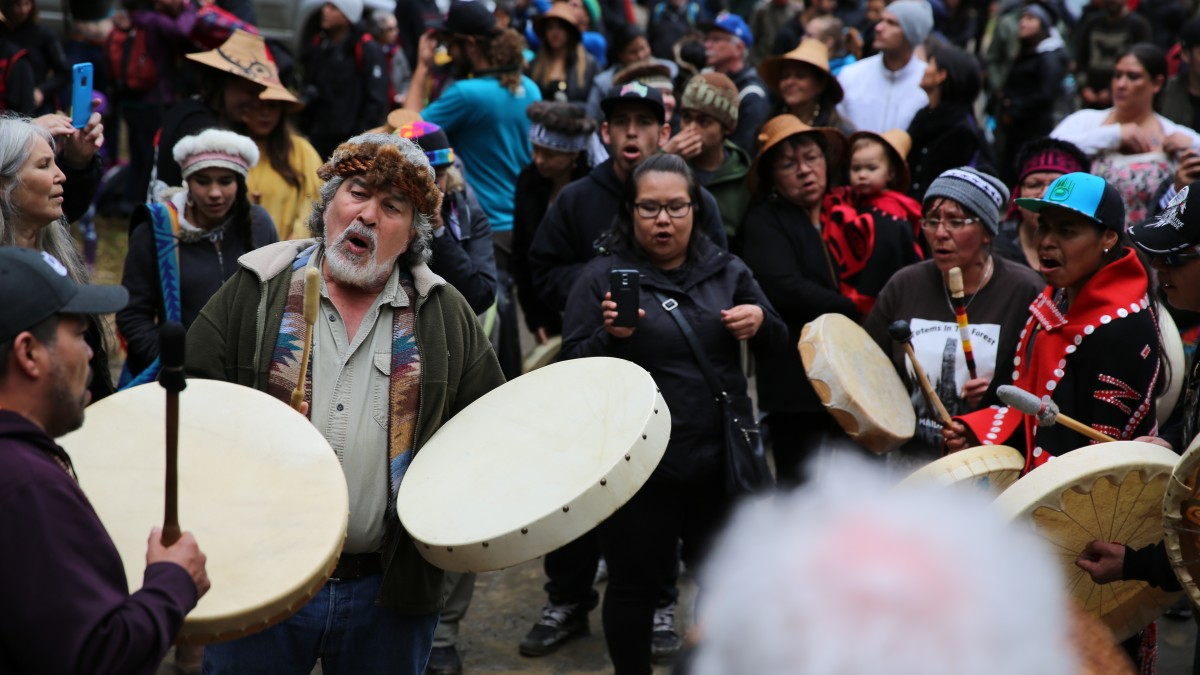 Guujaaw leads his tribe in song.