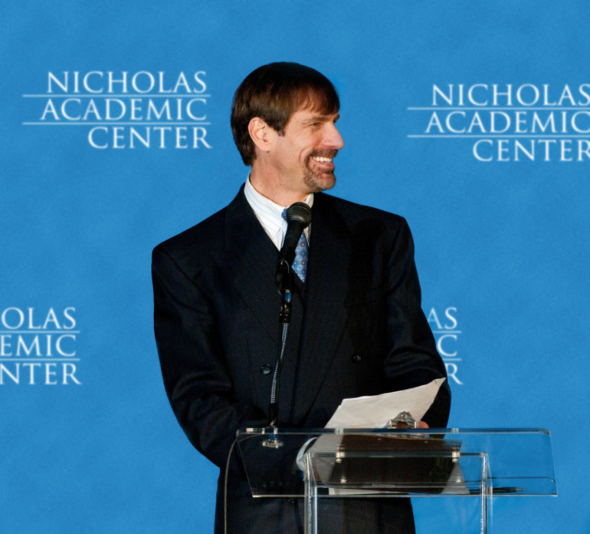 Henry Nicholas addressing Nicholas Academic Center graduates.