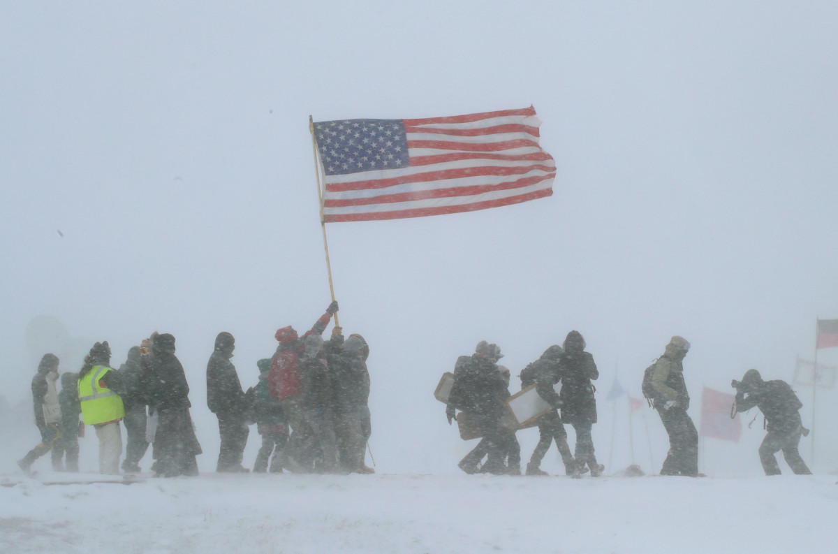 Despite blizzard conditions, military veterans march in support of the Water Protectors at Oceti Sakowin Camp on the edge of the Standing Rock Sioux Reservation on December 5th, 2016, outside Cannon Ball, North Dakota.