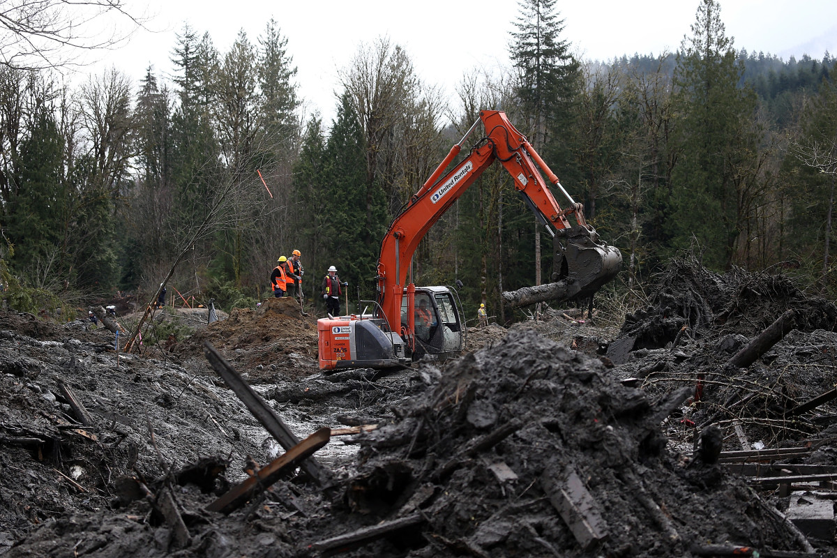 Search and rescue crews sift through debris from a deadly mudslide on April 4th, 2014, in Oso, Washington.