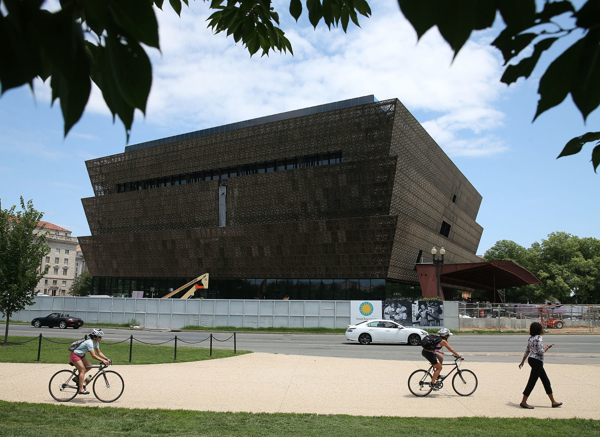 Tourists move past the Smithsonian Museum of African American History & Culture.