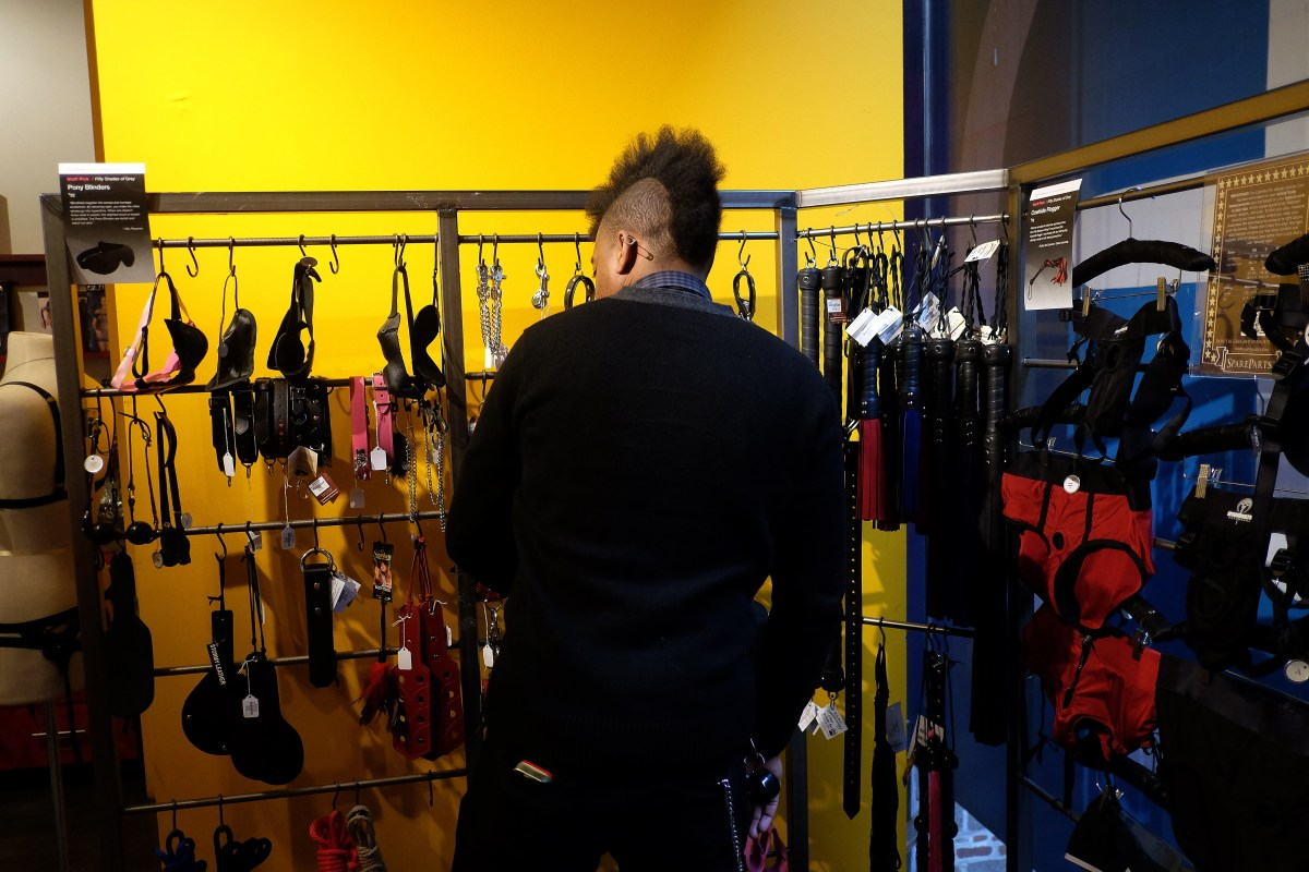A Babeland store manager arranges merchandise in New York on February 4th, 2015.