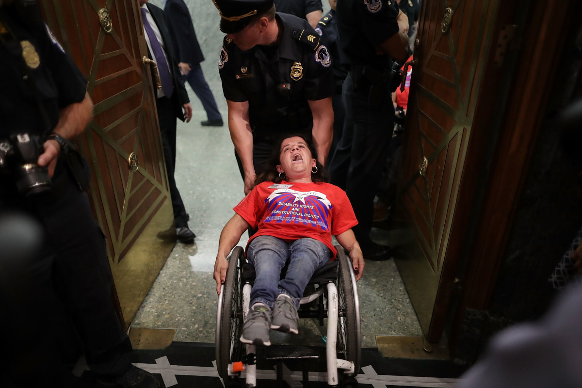 U.S. Capitol Police arrest disability rights protesters at a Senate Finance Committee hearing about the proposed Graham-Cassidy Health Care Bill in Washington, D.C., on September 25th, 2017.
