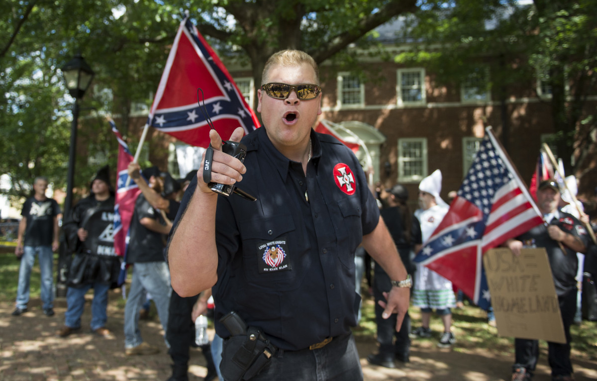 A member of the Ku Klux Klan shouts at counter-protesters during a rally in Charlottesville, Virginia, on July 8th, 2017.