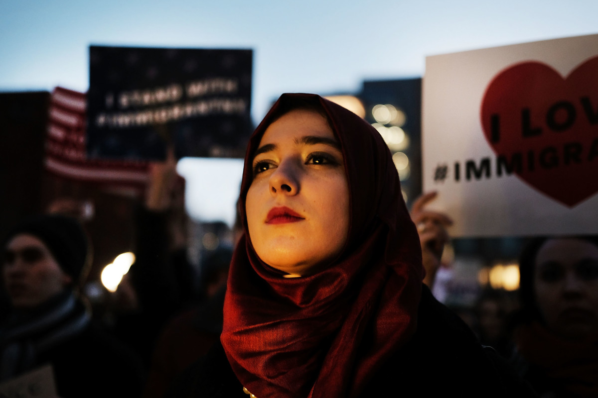Hundreds of people attend an evening rally at Washington Square Park in support of Muslims, immigrants and against the building of a wall along the Mexican border on January 25th, 2017, in New York City.