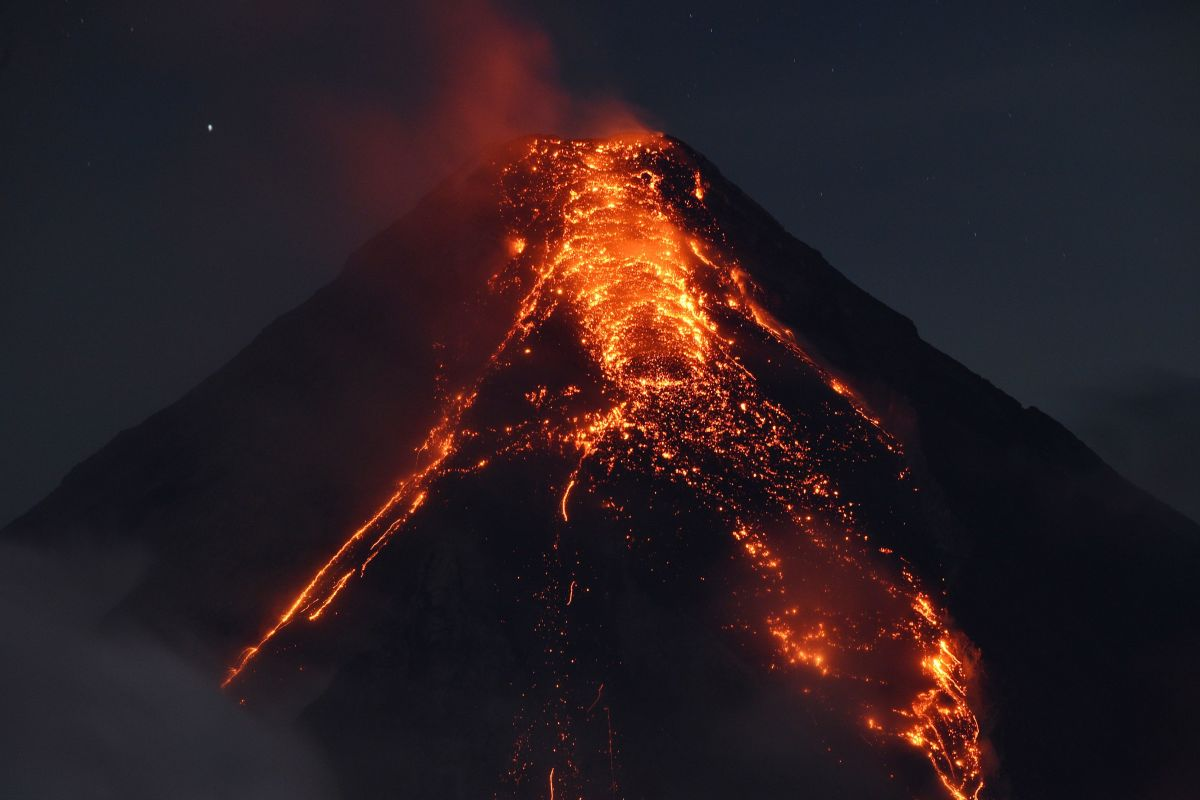 Lava flows from Mount Mayon on January 25th, 2018, as seen from south of Manila, the Philippines. Philippine authorities declared a no-go zone around the volcano after tens of thousands of residents fled to safety.