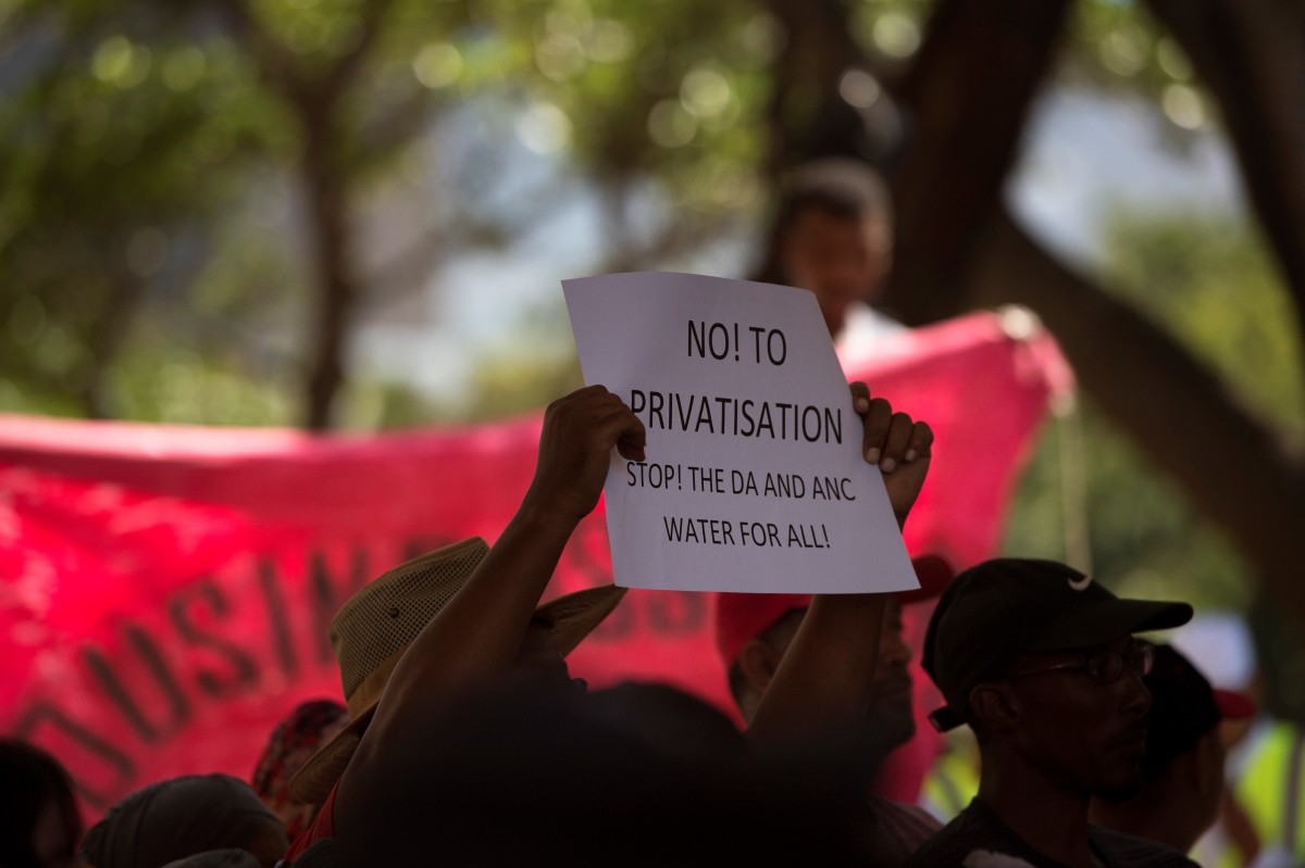 A woman holds up a placard during a protest in Cape Town, South Africa, on January 28th, 2018.