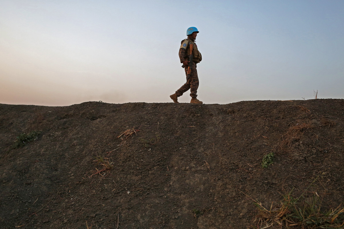 A U.N. peacekeeper patrols the edge of the protection site in Bentiu, South Sudan.
