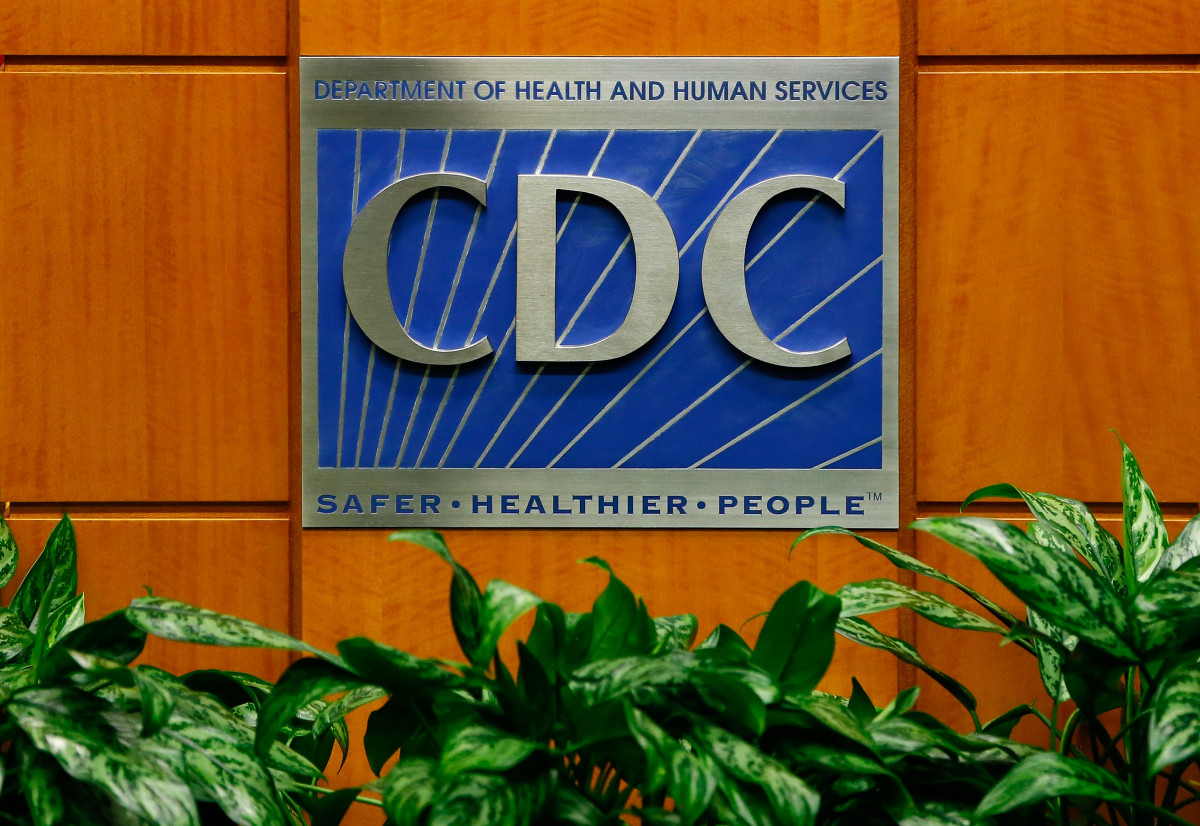 A podium with the logo for the Centers for Disease Control and Prevention.
