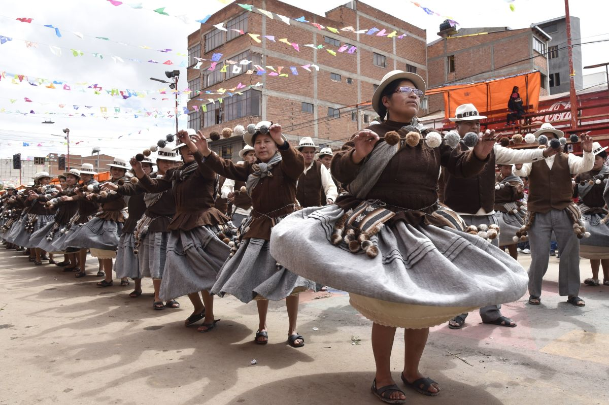 Aymara indigenous people perform traditional Andes highlands folk dances during the Anata Andino harvest festival in Oruro, Bolivia, on February 8th, 2018. During the harvest festival, native peasant farmers from different Bolivian highlands communities dance in the streets of Oruro giving thanks to Pachamama (Mother Earth) for the abundant crops.