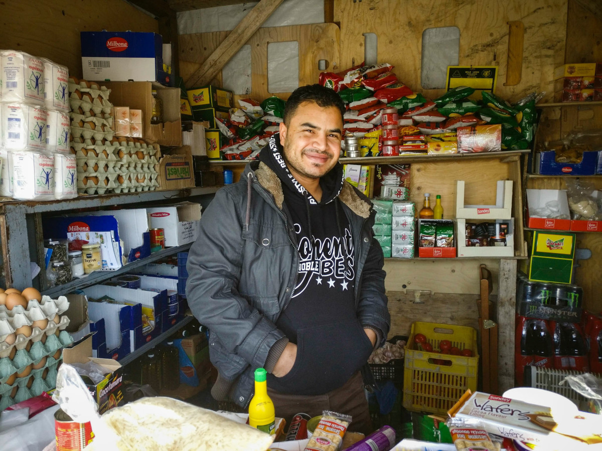 Sammy Hambod presiding over his grocery store in the Skaramagas camp outside Athens.