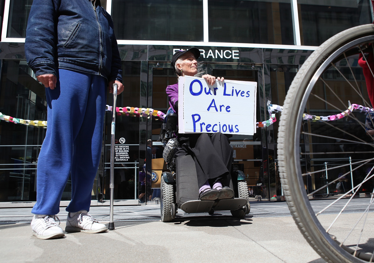 Disabled people carry signs as they protest cuts to Medicare on September 21st, 2011, in San Francisco, California.