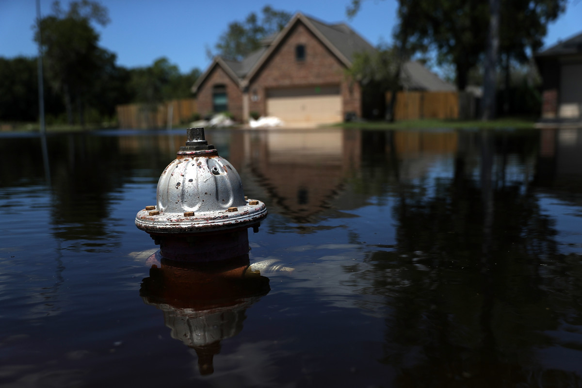 The top of a fire hydrant sticks out of floodwaters in front of a home on September 7th, 2017, in Richwood, Texas.
