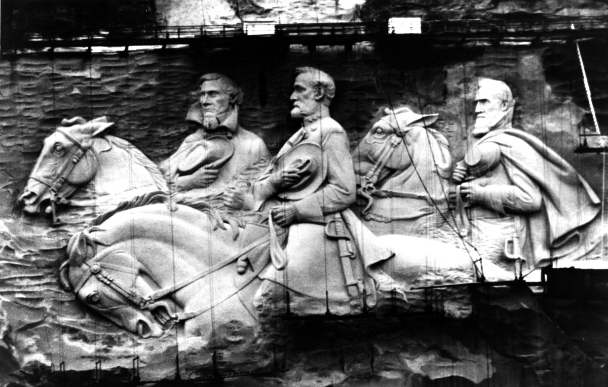 Giant figures sculptured in granite rock on Stone Mountain in Atlanta, Georgia. The figures represent Jefferson Davis, the only president of the Confederate States of America with Confederate Generals Robert E Lee and Stonewall Jackson.
