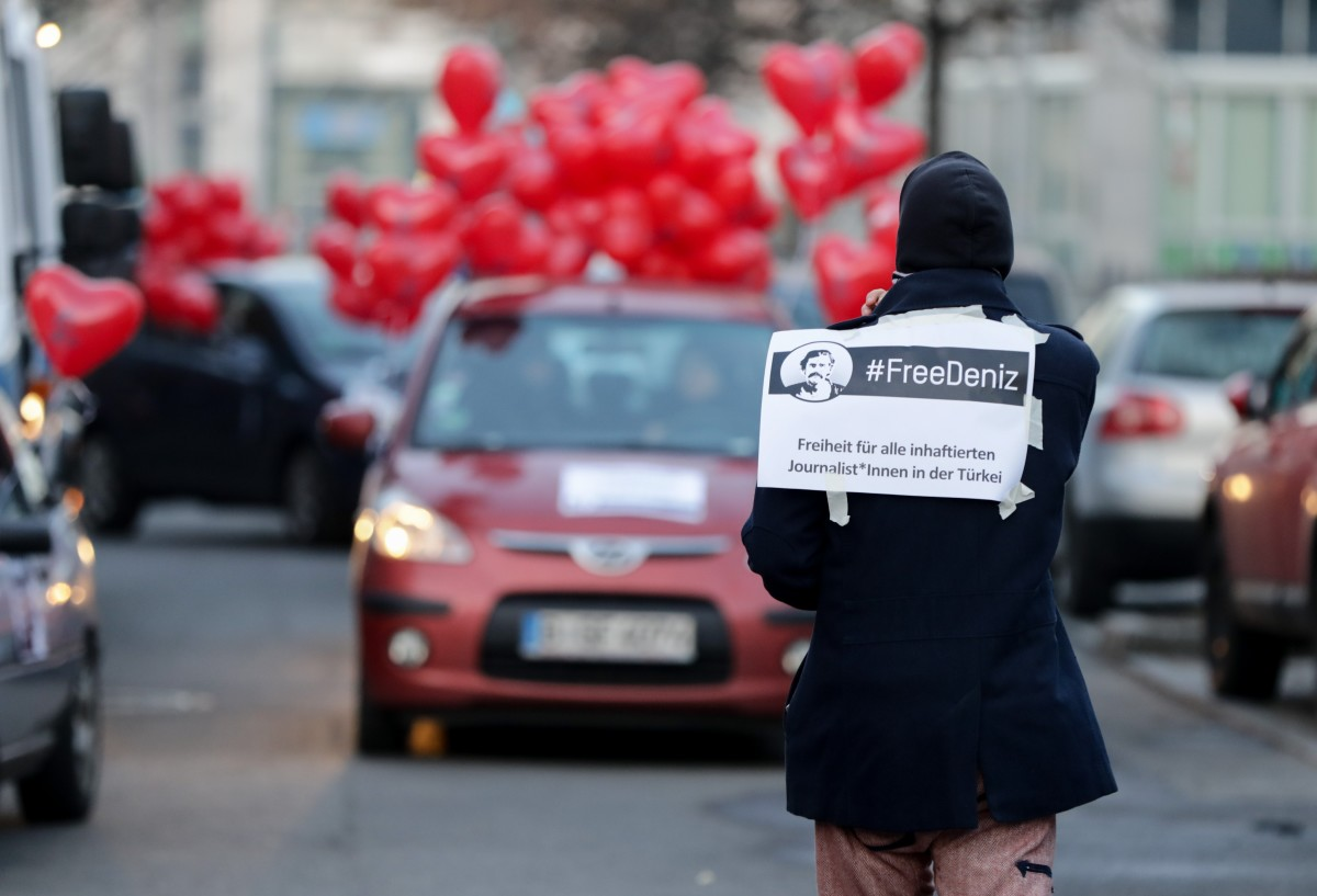 Supporters of German-Turkish journalist Deniz Yücel demonstrate with heart-shaped balloons during a motorcade protest on February 14th, 2018, in Berlin, Germany. The day marks Yücel's first full year in custody in Turkey without charge. Turkish Prime Minister Binali Yildirim expressed hope ahead of key talks in Berlin that Yücel would soon be freed after spending one year behind bars.