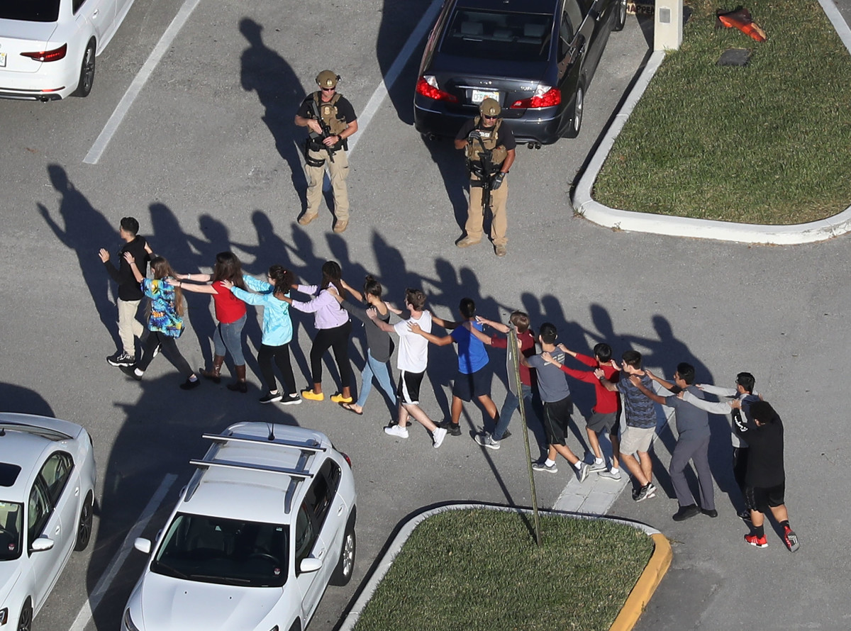 People are brought out of the Marjory Stoneman Douglas High School after a shooting on February 14th, 2018, in Parkland, Florida.