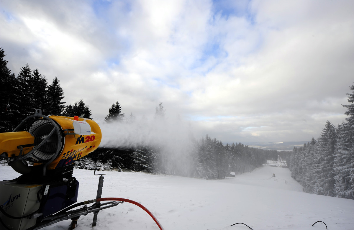 A snow cannon blowing snow onto a ski slope.
