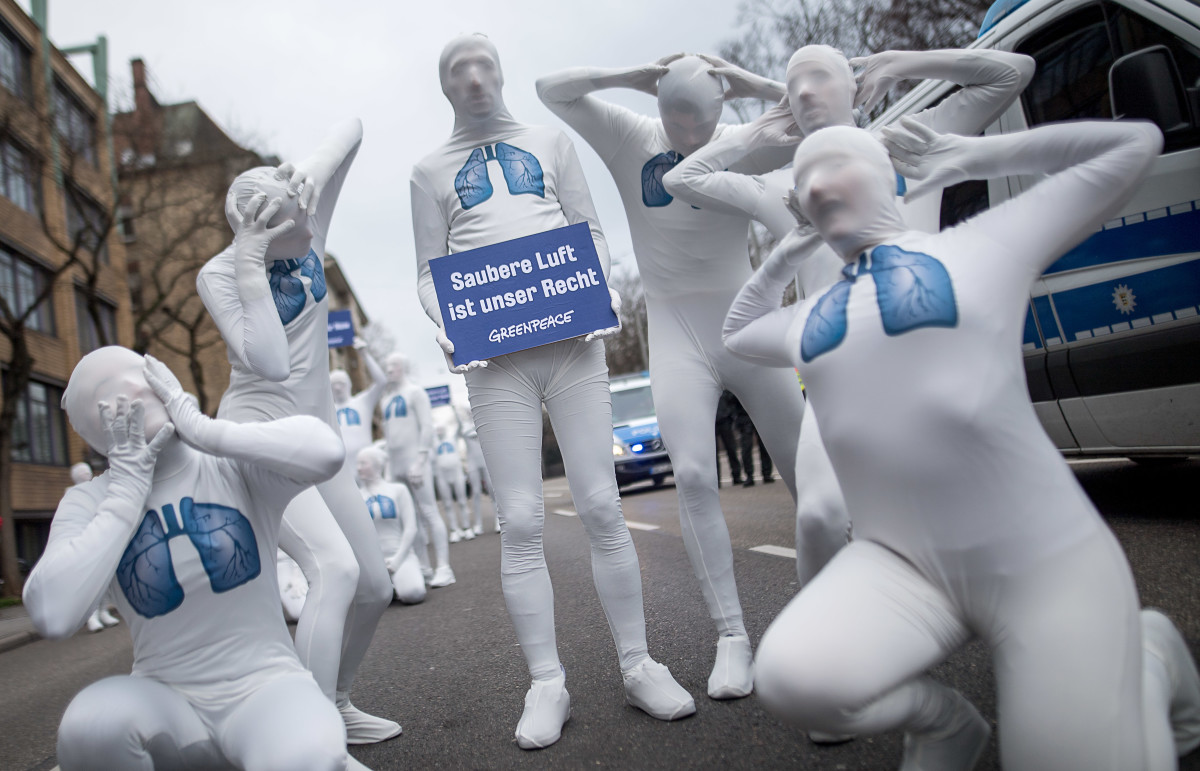 "Greenpeace activists hold a poster reading ""We Have the Right to Clean Air"" as they stage an action against diesel exhaust on February 19th, 2018, in Stuttgart, Germany. A verdict of Germany's Federal Administrative Court is expected on February 22nd, ruling whether cities with high nitrogen oxide pollution could be allowed to ban diesel cars."