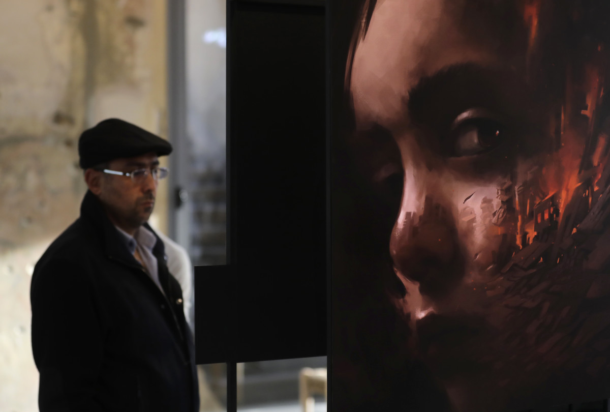 "People visit the exhibition ""Haneen, a Collective Work of Lebanese and Syrian Artists on the Impact of War on Childhood,"" in Beirut, the capital city of Lebanon, on February 20th, 2018. The United Nations Children's Fund (UNICEF) launched the exhibition, which underlines how children experience war through works inspired by poetry by Syrian refugee children."
