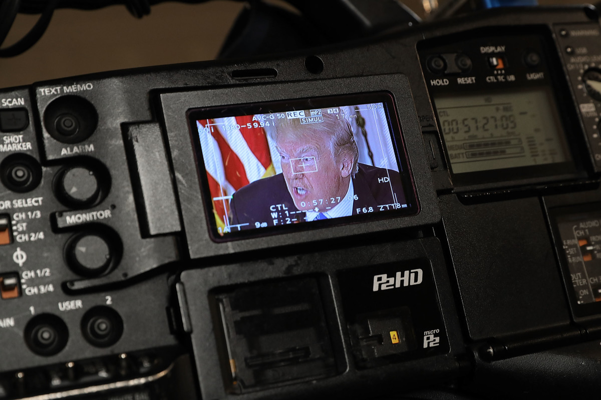 President Donald Trump appears on a television camera monitor during a meeting with state and local officials to unveil his administration's long-awaited infrastructure plan in the State Dining Room at the White House on February 12th, 2018, in Washington, D.C.
