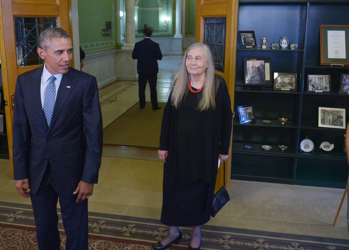 President Barack Obama and Marilynne Robinson arrive for a visit to the State Library of Iowa during an unannounced stop on September 14th, 2015, in Des Moines, Iowa.