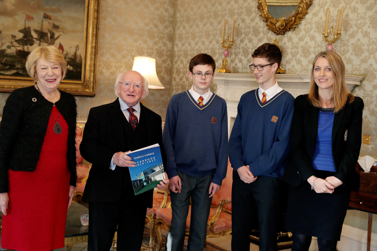Irish President Michael Higgins (second from the left) poses with two students and two faculty members from Temple Carrig School.